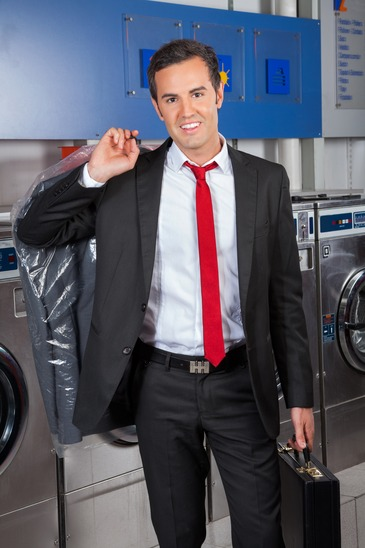 Busy professionals use EZ Wash's wash dry and fold laundry service